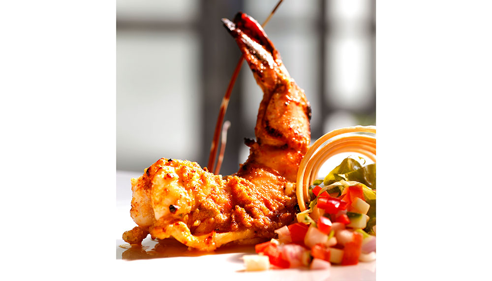 Tiger prawn stuffed with cray fish in saffron low-fat yoghurt marinade
