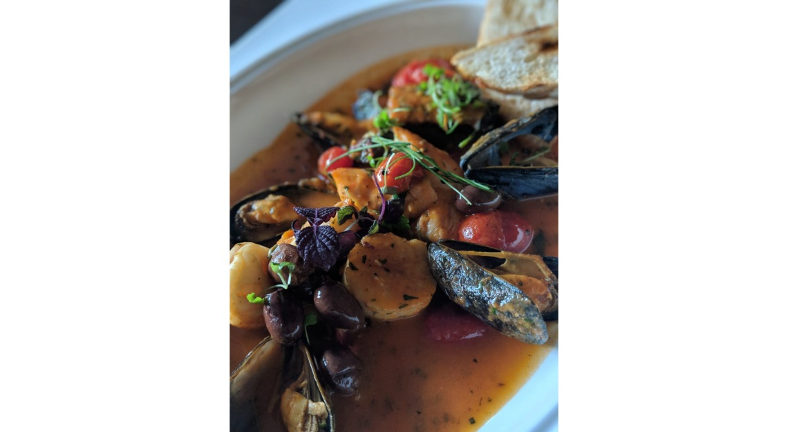 basilico Tuscan-style Seafood Stew with Sea Bass, Salmon, Mussels, Prawns, Scallops, Olives, Fava Beans and Capers